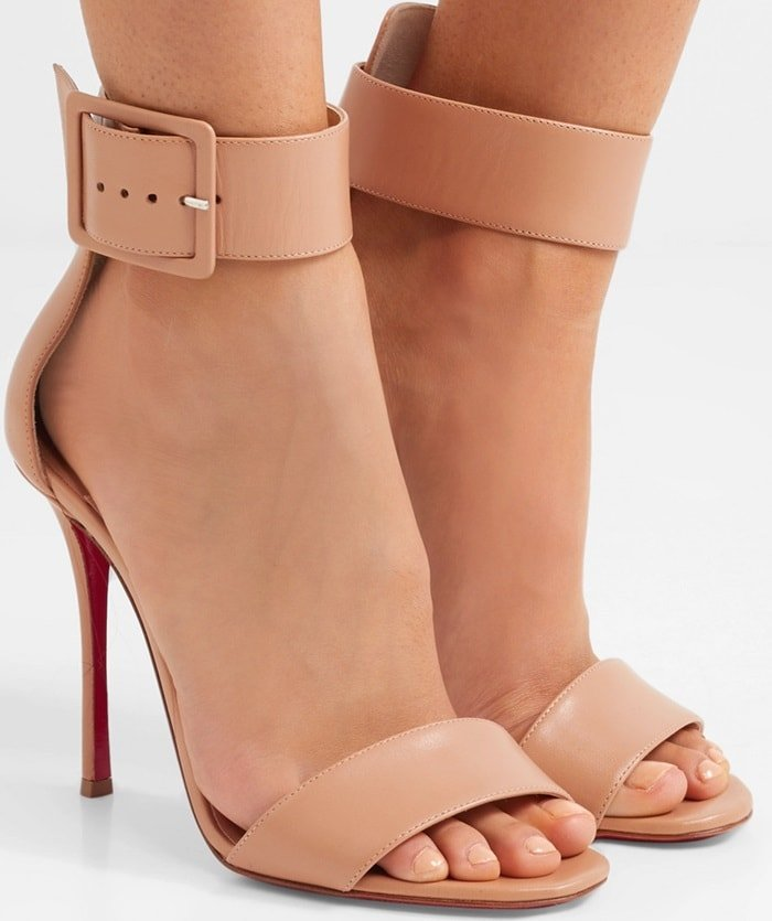 The wide buckled strap is precisely crafted to sit just above your ankle for a slimming effect