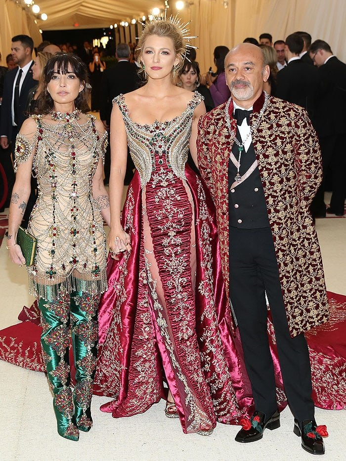 Blake Lively posing with Christian Louboutin and a guest at the 2018 Met Gala.