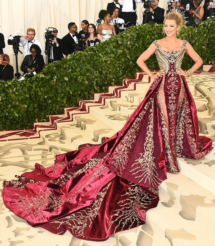 Blake Lively wearing Atelier Versace gold-and-red gown with a long train and custom Christian Louboutin sandals.