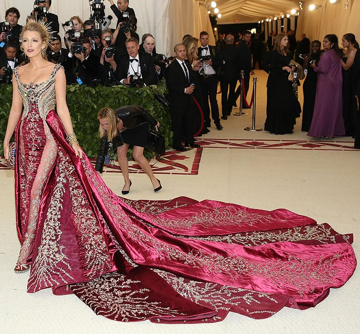 Blake Lively showing leg and Louboutin heels through the sheer panels on her Atelier Versace gown.