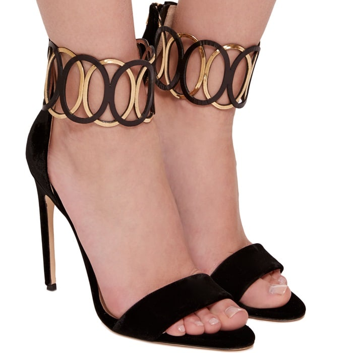 This sandal is rendered in velvet and features a minimalist silhouette and ankle embellishment