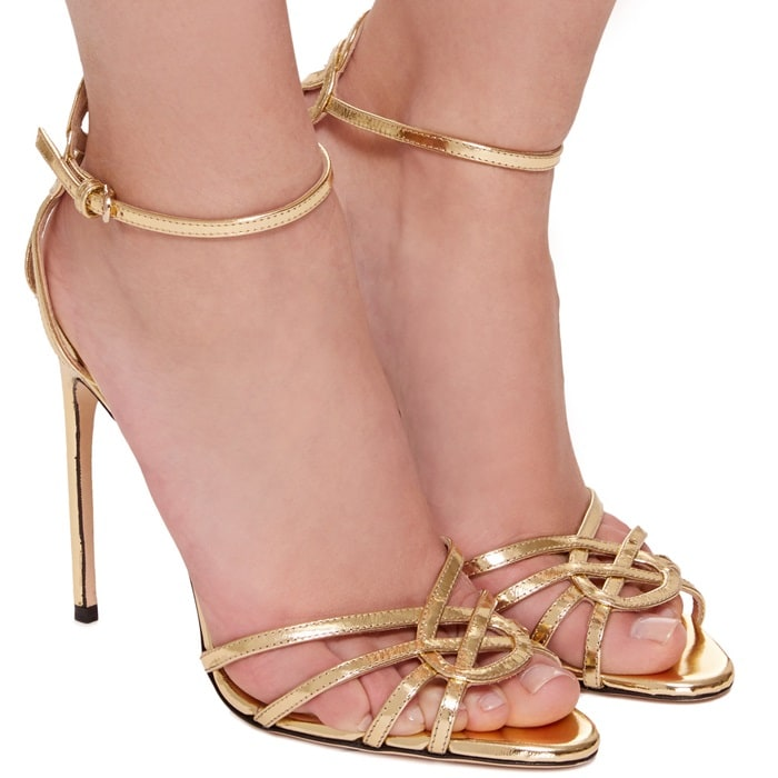 This sandal is rendered in specchio leather and features a strappy detail and metallic finish