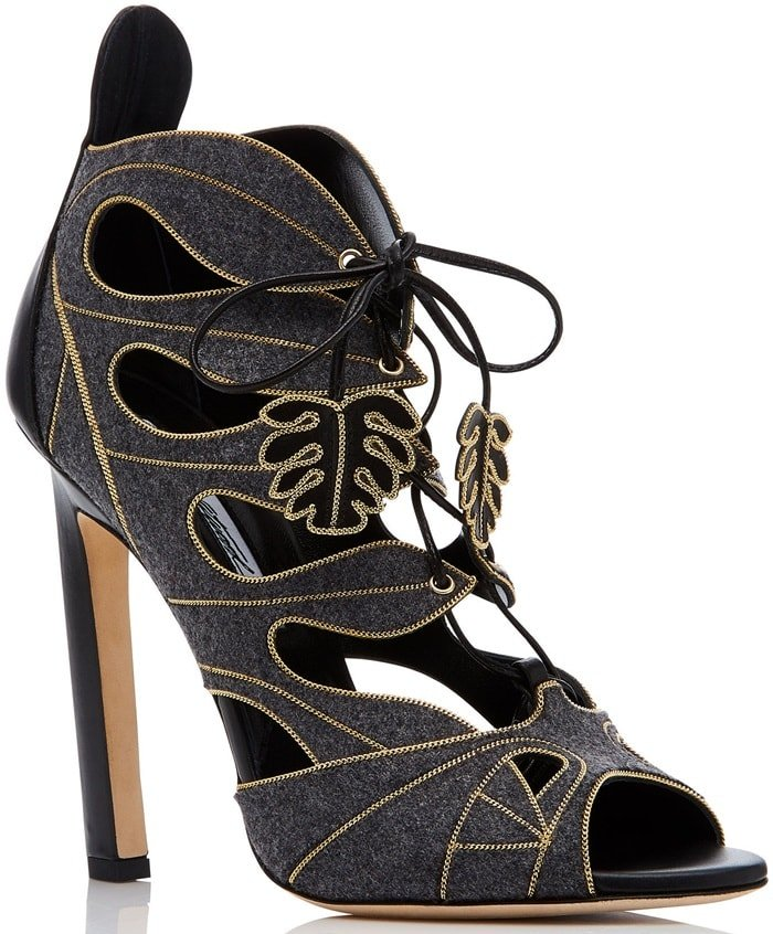 This almond toe sandal is rendered in kid leather and features a felt finish and cut-out detail