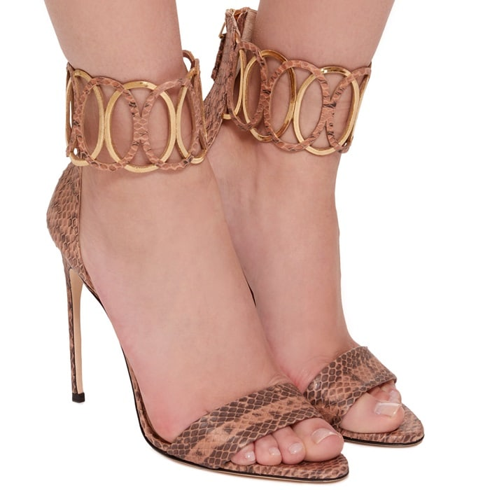 This sandal is rendered in python and features a minimalist silhouette and ankle embellishment