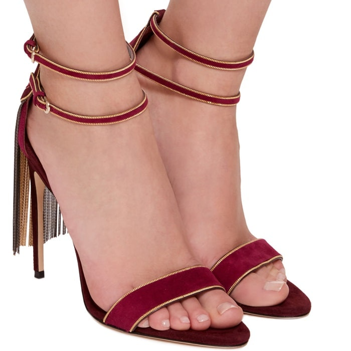 This sandal is rendered in kid suede and features a fringe embellishment and strappy detail