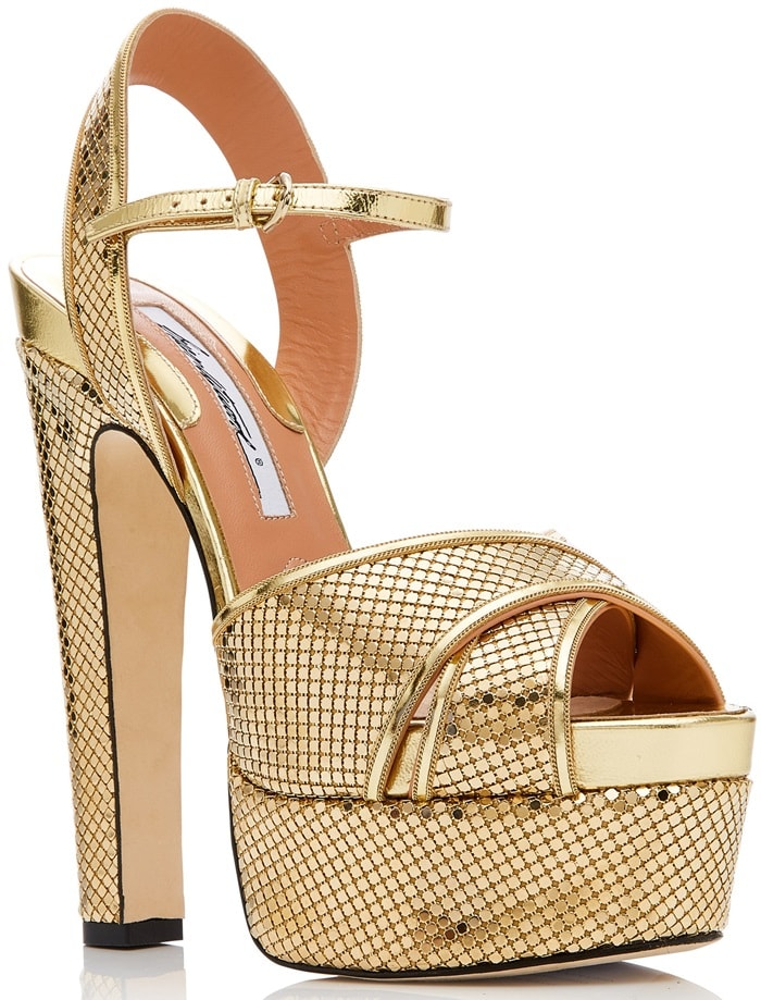This sandal is rendered in specchio leather and features a metallic finish and platform detail