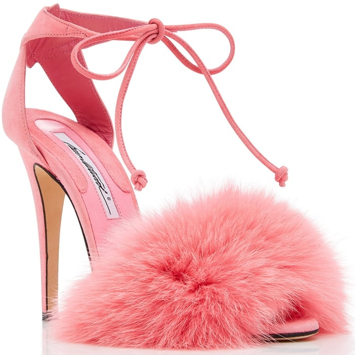 This sandal is rendered in pink kid suede and features a fur embellishment and strap detail