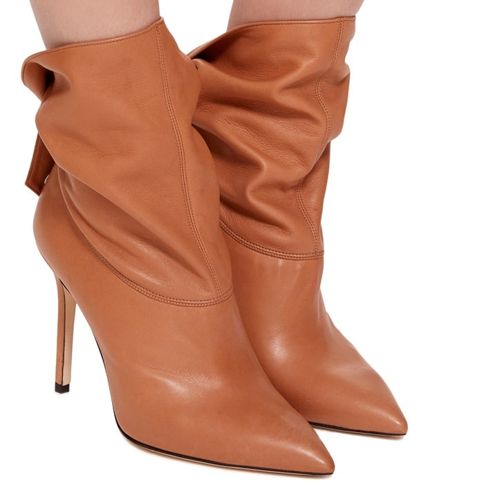 This bootie is rendered in nappa leather and features a stiletto heel and strap detail