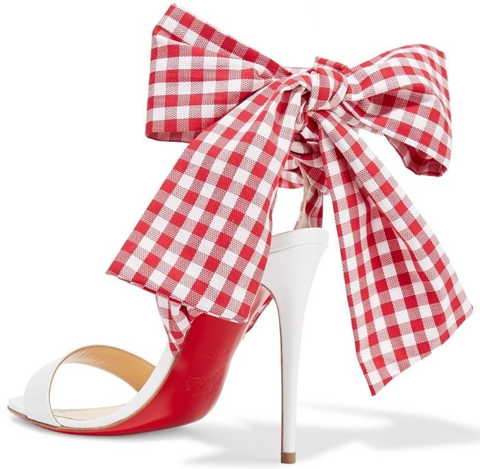These sandals are topped with gingham canvas ties that wind around your ankle and tie into a pretty bow