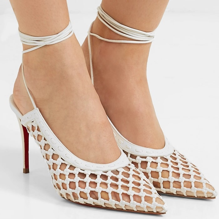 These striking white pumps are made in Italy from nappa leather to form an elegant netting across the clear mesh vamps and sides
