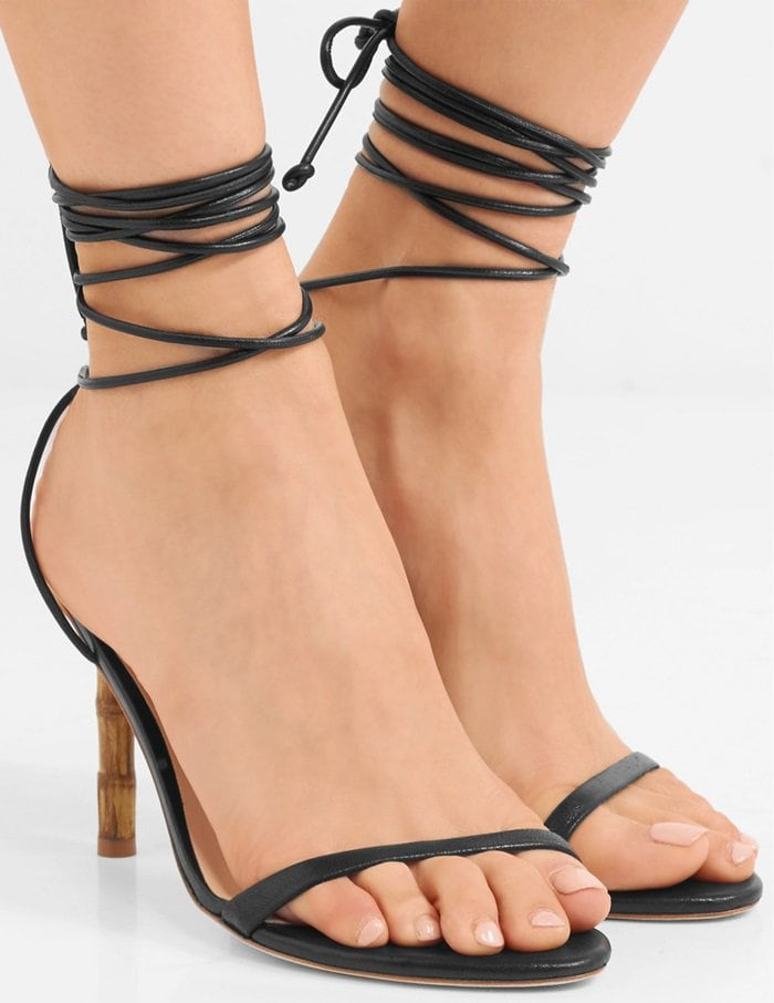 This stiletto pair is made from smooth black leather and has slender ties that snake around the ankle