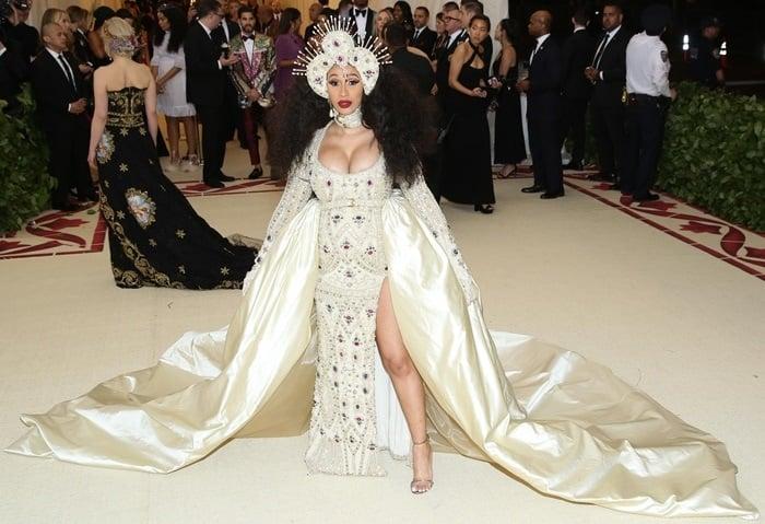 Cardi B wearinga Moschino by Jeremy Scott bejeweled floor-length dress