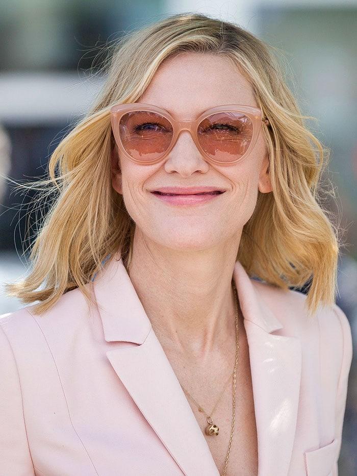 Cate Blanchett wearing Andy Wolf 'Grace' pink cat-eye sunglasses.