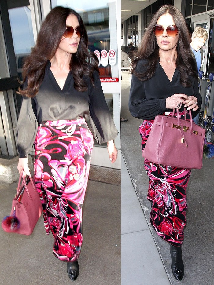 Catherine Zeta-Jones in a black blouse, a pink swirly-pattern skirt, and Chanel flower-toe boots.