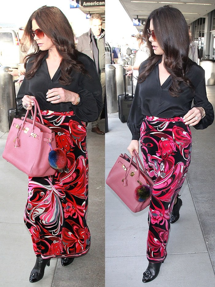 Catherine Zeta-Jones wearing Chanel 'Camellia' ankle boots with a pink, swirly-pattern skirt