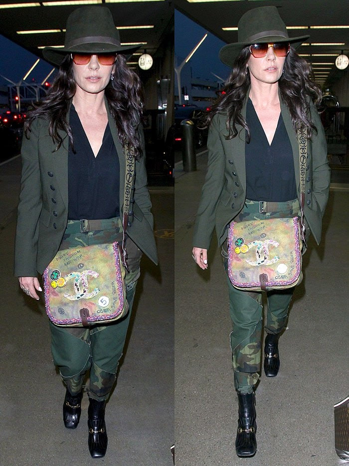 Catherine Zeta-Jones wearing a dark-green outfit, a Chanel graffiti bag, and Gucci 'Polly' horsebit boots.
