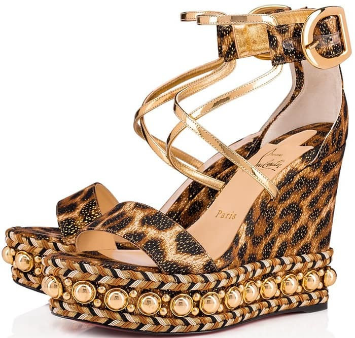 Its braided platform, with tawny-hued threads and golden studs, reveals the meticulous savoir-faire of the Louboutin House