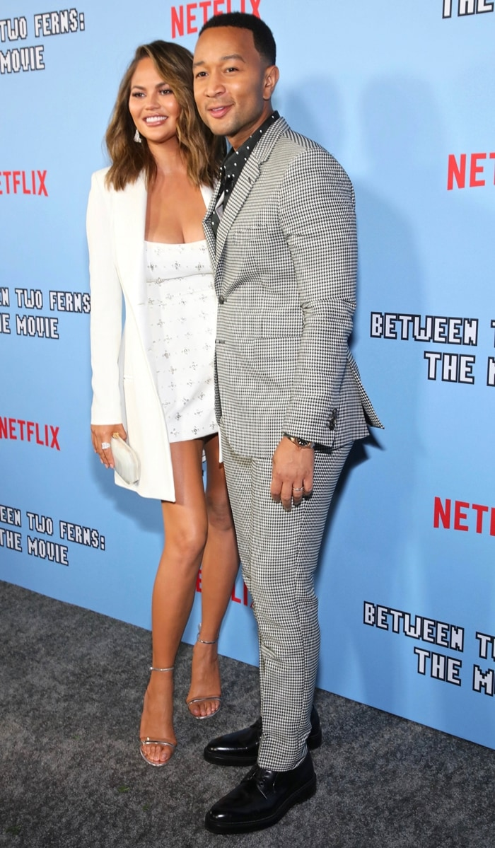 Chrissy Teigen and her husband John Legend strike a pose at the premiere of their new Netflix comedy film Between Two Ferns: The Movie