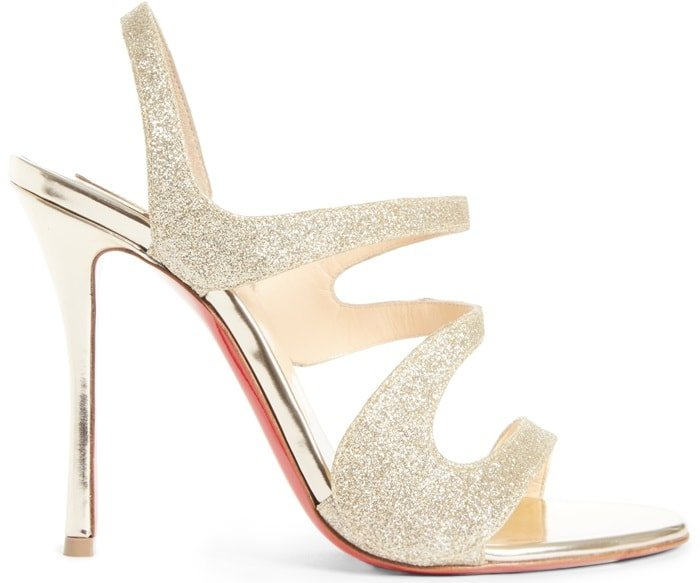 Christian Louboutin's light gold glitter Vavazou sandals feature asymmetric cutouts and a leg-lengthening specchio leather stiletto heel