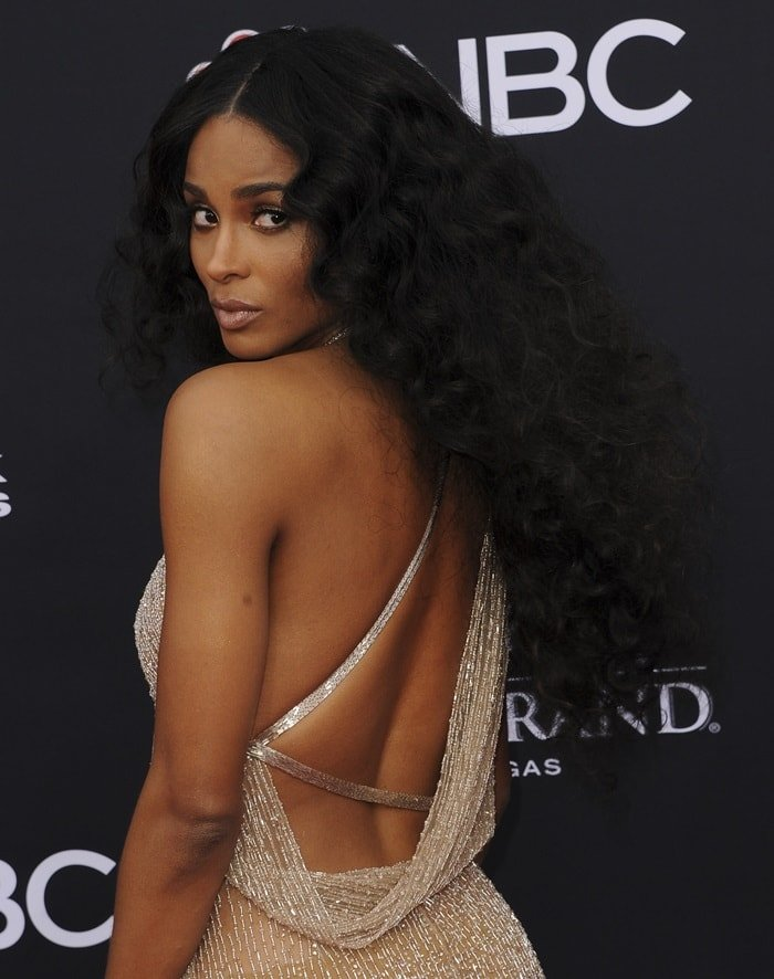 Ciara in a nude-coloredbarely-there Julien Macdonald Spring 2018 dress