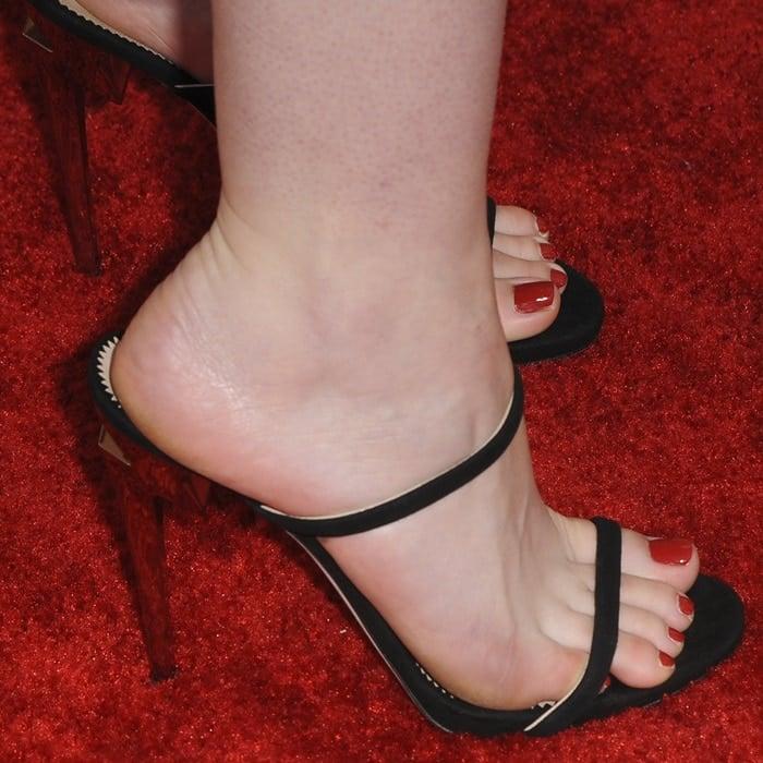 Dakota Fanning showing off her feet in black suede upper 'G Heel' mules with sculpted heels