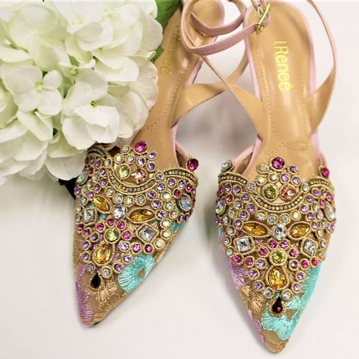 Elegant embroidery and sparkling crystals embellish the pointy toe of a gorgeous, sparkling pump secured by a slim strap that wraps around the ankle