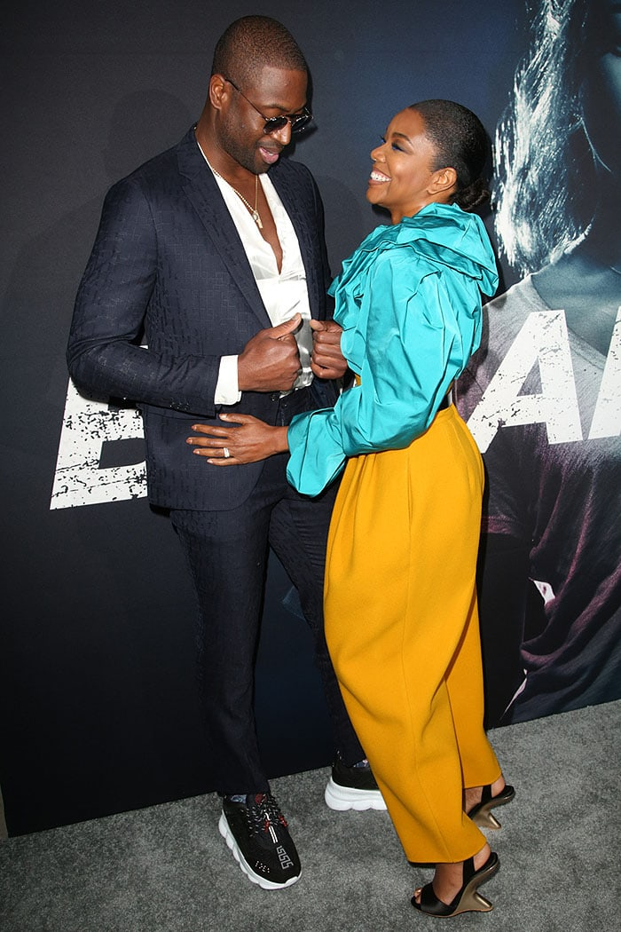"Gabrielle Union joined by husband Dwyane Wade at the premiere of her movie ""Breaking In."""