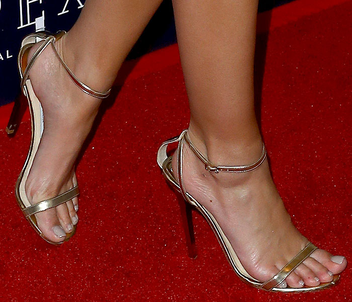 Details of the metallic gold Jimmy Choo 'Minny' sandals on Emily Ratajkowski.