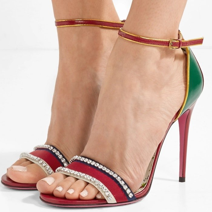 These sandals are designed in a sleek silhouette with creative director Alessandro Michele's maximalist detailing for a statement finish