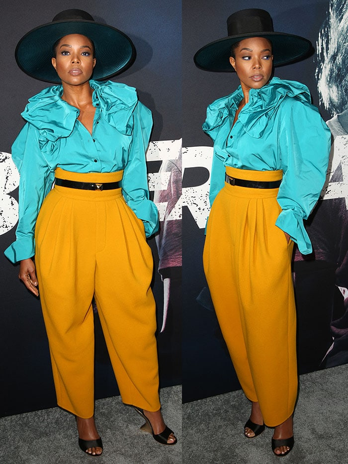 Gabrielle Union wearing a Marc Jacobs blue ruffled blouse and yellow pants with Salvatore Ferragamo curved wedges.