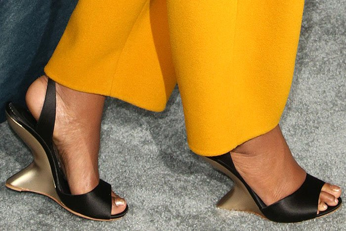Closeup of the Salvatore Ferragamo 'Arsina' curved-wedge sandals on Gabrielle Union.