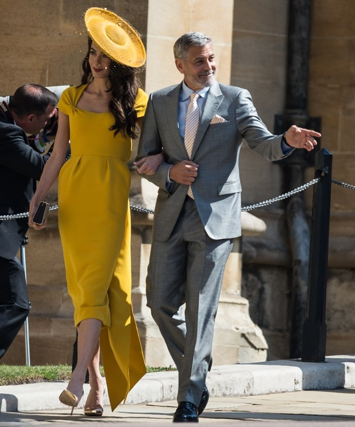 Amal Clooney donned a bespoke honey yellow midi dress by Stella McCartney with side tie detail in silk cady