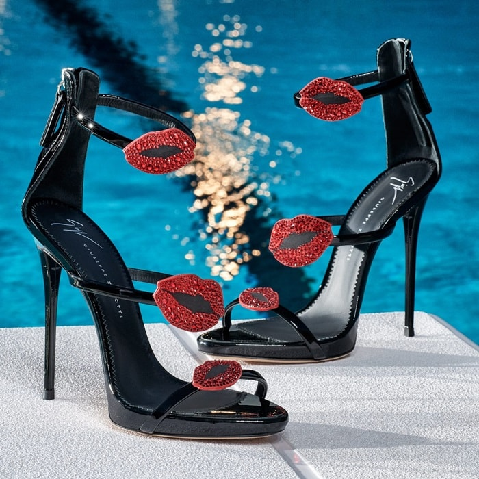 Slip into these standout mirrored mules from Giuseppe Zanotti Design. Made in Italy, these stiletto sandals are made from patent leather, these sandals have a cages strap design, an open toe, a branded insole and a high stiletto heel