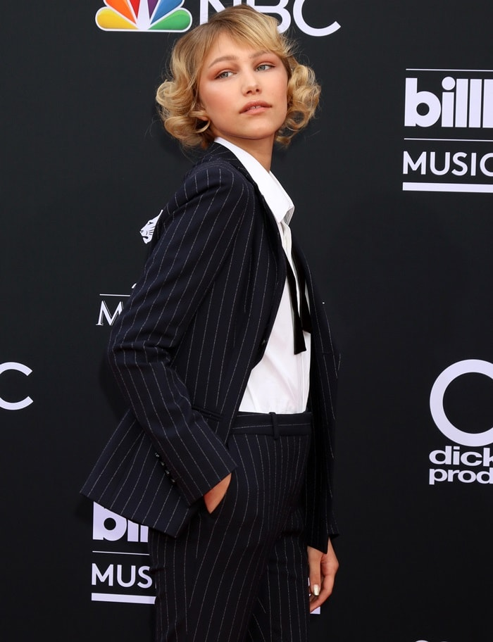 Grace VanderWaalwearingpinstripe suit trousers and a matching double breasted suit jacket