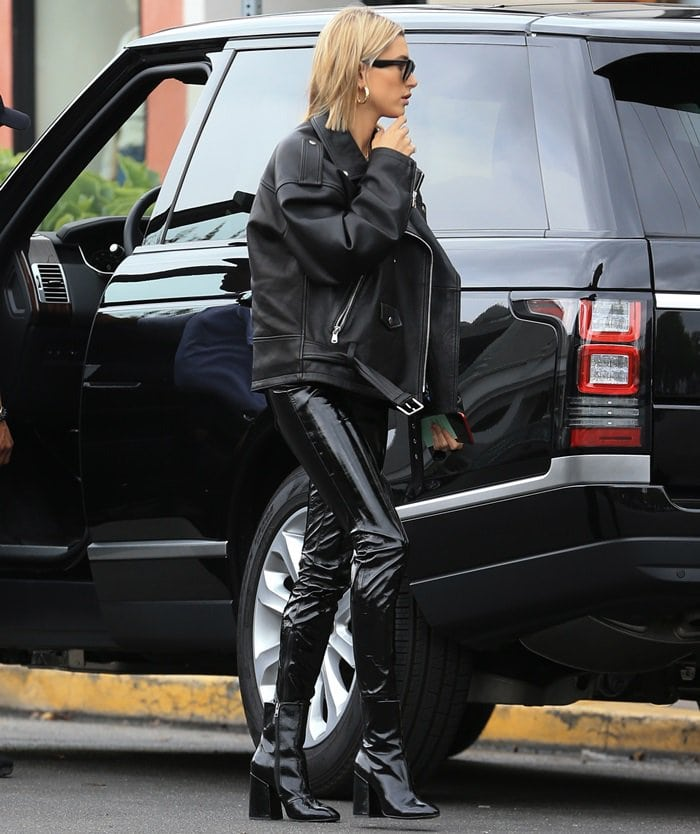 Hailey Baldwin rocking patent leather 'Feel' boots by Ash
