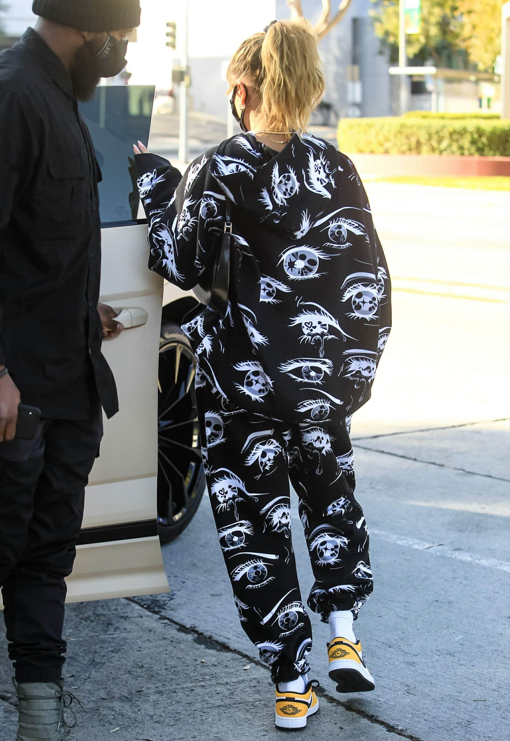 Hailey Rhode Bieber wears a printed hoodie and matching joggers from Billie Ellish's collaboration with Bershka