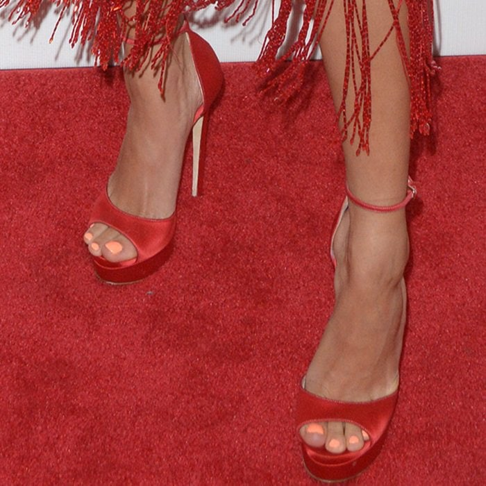 Hailey Baldwin showing off her feet in red sky-high sandals