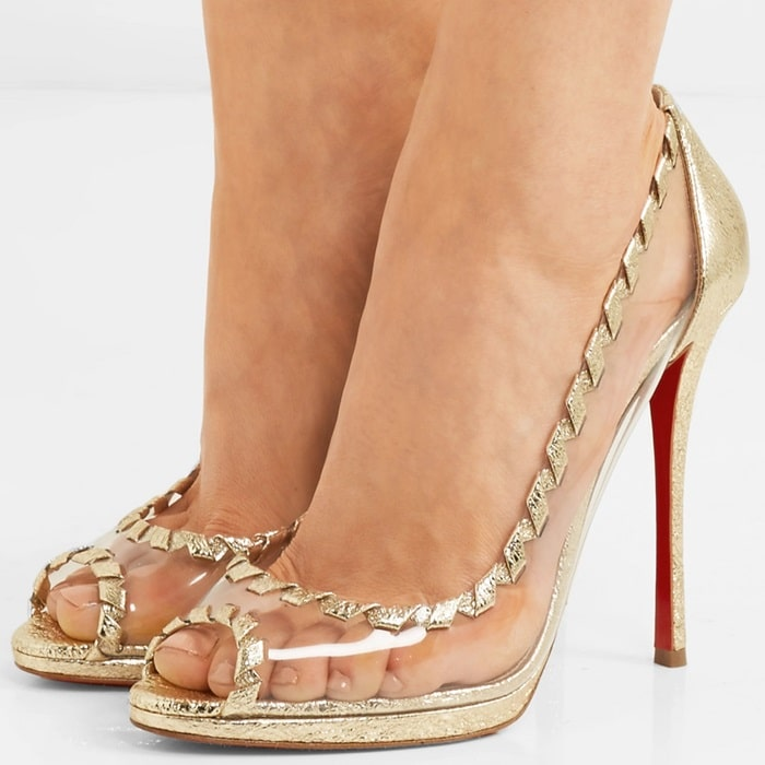 Metallic details merge with lace-up trim on translucent pumps
