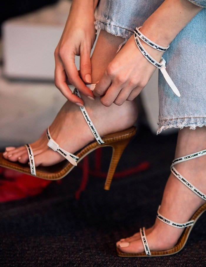 These lust-worthy sandals are set on a sleek stacked-wood stiletto heel