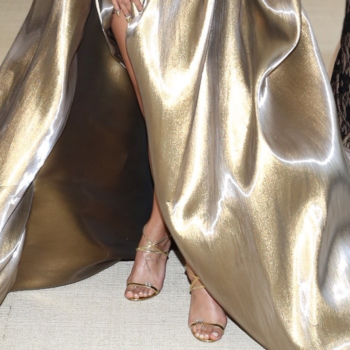 Jasmine Sanders' feet ingold strappy Ellie sandals with dual crystal embellishments from Giuseppe Zanotti