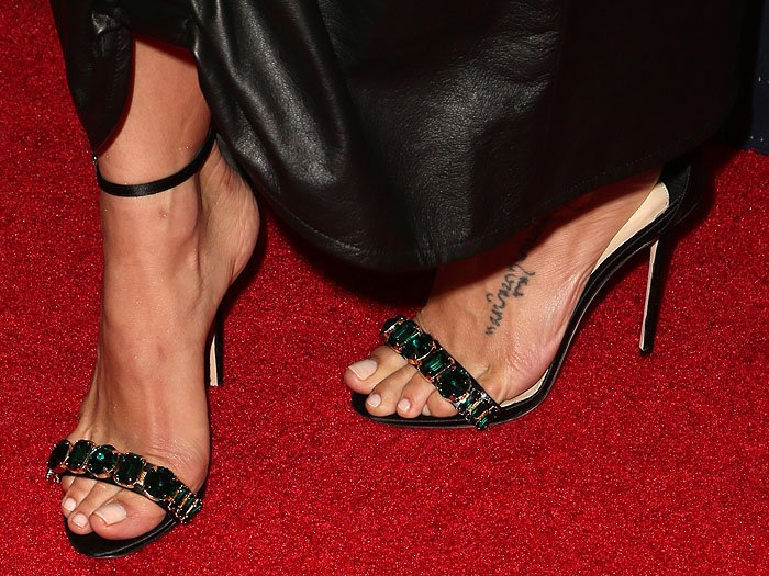 Details of Jenna Dewan's Olgana Paris 'Delicate' black-satin ankle-strap sandals with green jewels on the toe straps.