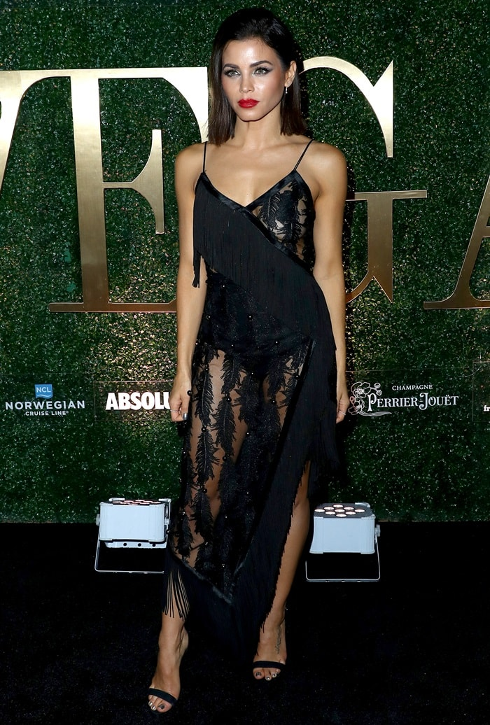 Jenna Dewan in a feather-embellished short black fringe dress featuring spaghetti straps and sheer paneling