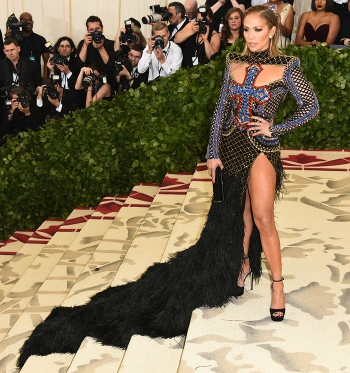 Jennifer Lopez donned a beaded blue, black and feathered Balmain gown