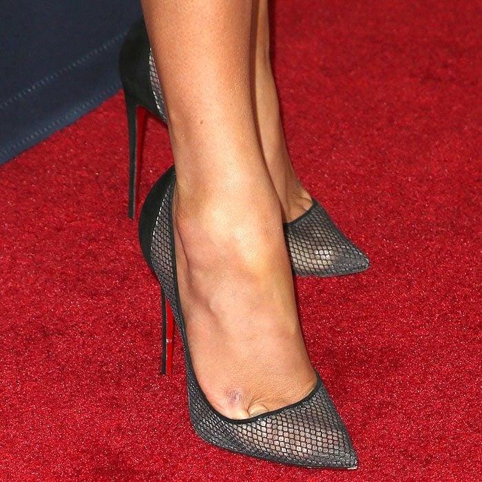 Closeup of the Christian Louboutin 'Follies Resille' pumps on Jennifer Lopez.