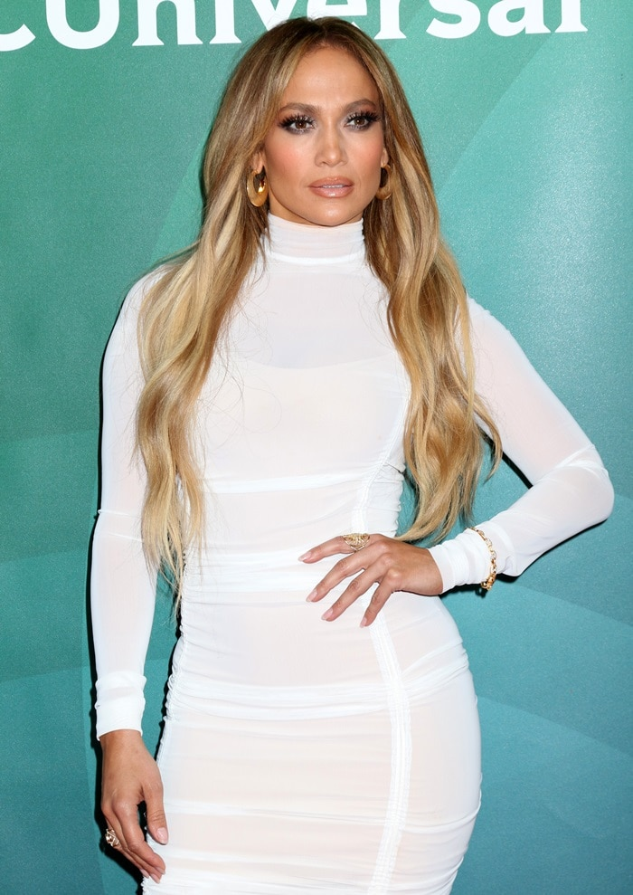 Jennifer Lopez in a ruched fitted knee length August Getty Atelier dress