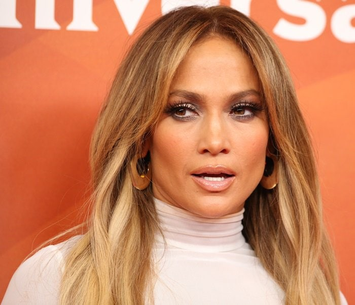 Jennifer Lopez showing off her statement earrings