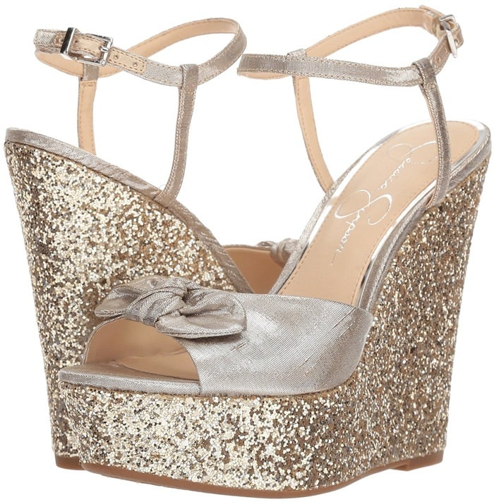 Take your glam look to new heights with the captivating shimmer silver metallic platform wedge sandal