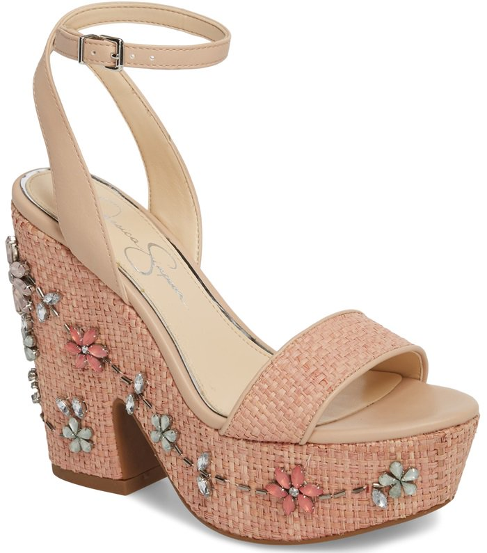 puts a stylish touch on a classic silhouette with a sculpted wedge heel and flower ornament detail