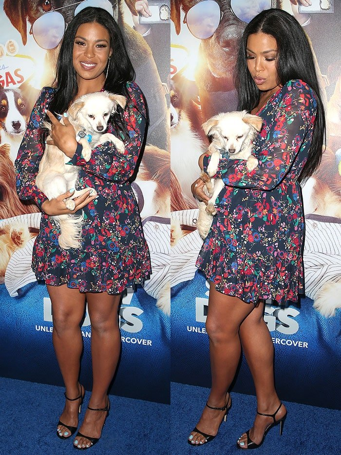 "Jordin Sparks posing with a dog at the ""Show Dogs"" premiere"