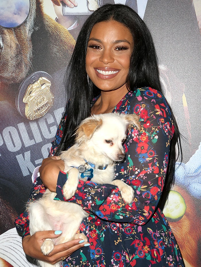 "Jordin Sparks holding a dog at the ""Show Dogs"" premiere"